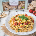Wholemeal fettuccine with pistachio pesto, courgettes and confit cherry tomatoes